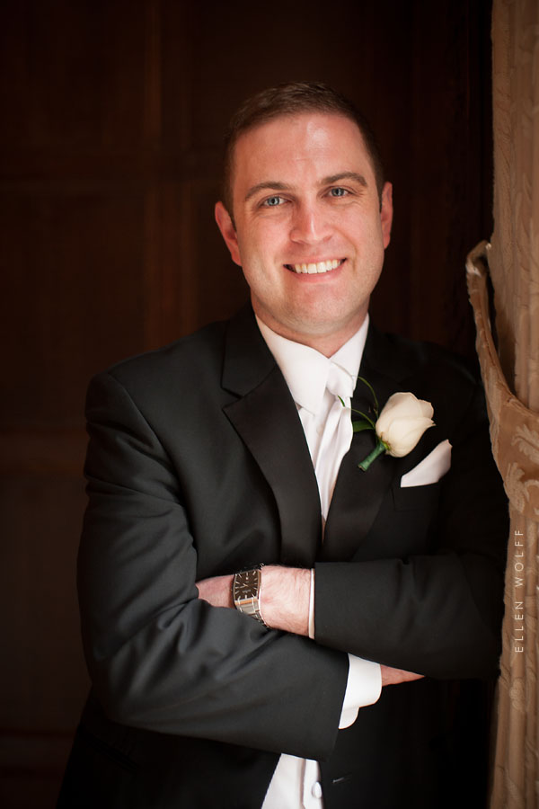 the groom wearing a white tie