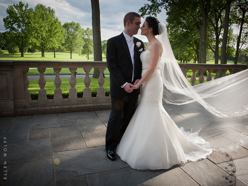bride and groom at Muttontown Club overlooking the golf course