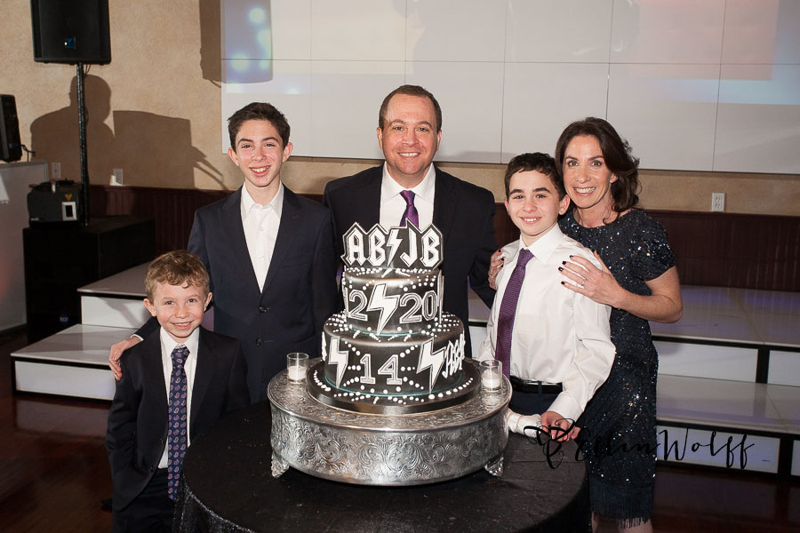 The family poses with the custom Bnot Mitzvah cake at Temple or Elohim Jericho Long Island