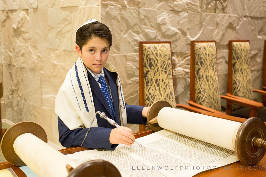 bar mitzvah photo with an open torah scroll