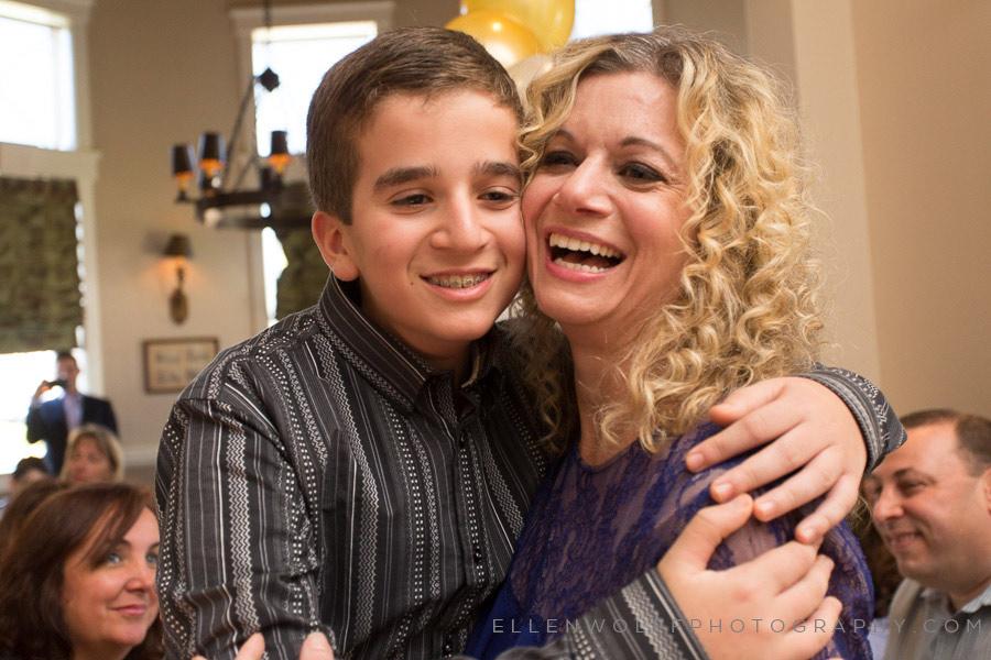 joyous bar mitzvah boy and mom