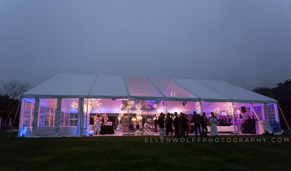 white party tent with purple interior lighting